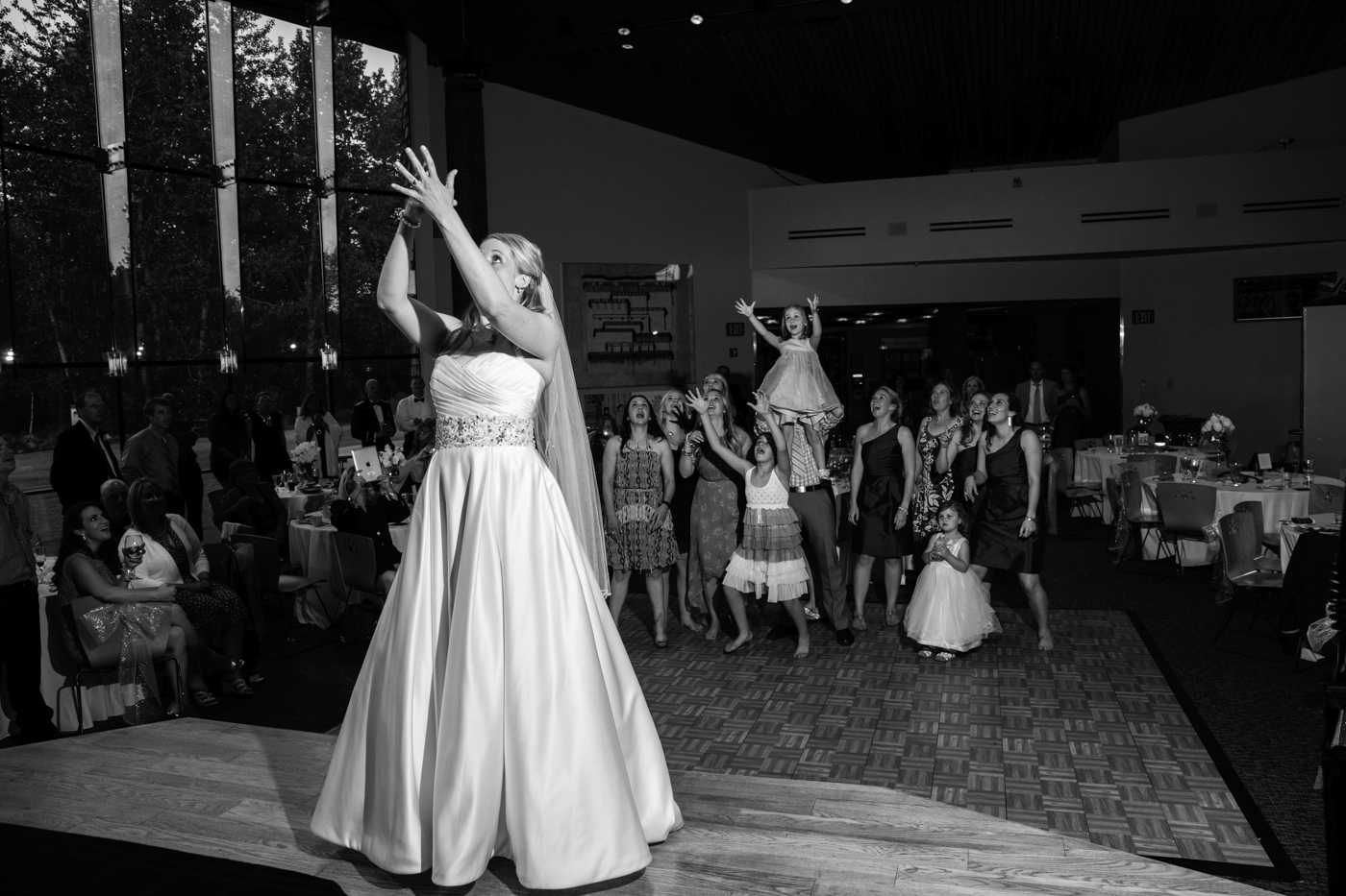 Wedding Bouquet Toss at Alaska Native Heritage Center - Photo credit Chugach Peaks Photography